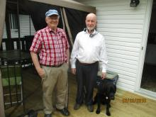 Paul Dixon VE1AIN with Jim Noseworthy VE1HJN and guide dog Orlando